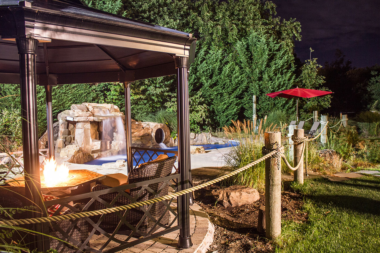 gazebo with firepit and pool fx design team